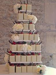 3 tier wicked chocolate wedding cake decorated with dark chocolate