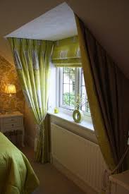 dormer window with show curtains and matching roman blind window
