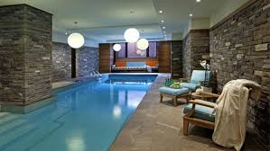 mesmerizing modern rectangle indoor pool design with brick stone