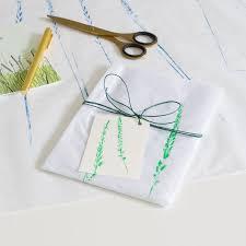 Tissue Paper Gift Wrap - tissue paper gift wrap with handprinted grass head in three colours