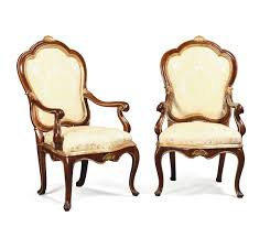 Louis Xv Armchairs A Pair Of Louis Xv Armchairs In Walnut With Golden Profiles