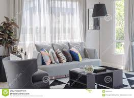 Living Room Pillows by Colorful Pillows On Modern Grey Sofa In Living Room Stock Photo