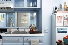 should i paint my kitchen cabinets the same color as my trim this paint trick makes rooms look much more expensive