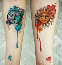 picture of sun and blue moon tattoos on the arms