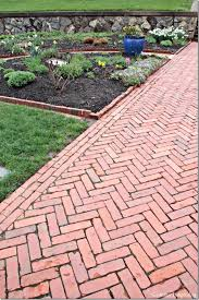 backyard garden with herringbone brick paver beautiful timeless