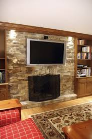 interior futuristic brick stone fireplaces with tv wall and