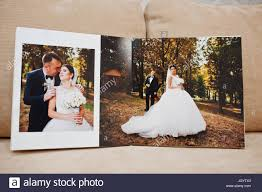 wedding album pages pages of wedding photobook or wedding album on the sofa with