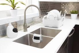kitchen sink cabinet sponge holder saddle sink caddy shop kitchen organization umbra