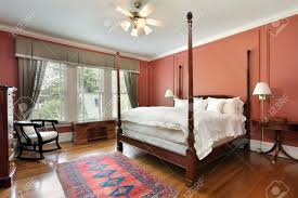 colored walls master bedroom in luxury home with salmon colored walls stock photo