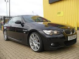 used bmw 3 series 2009 black colour petrol 330i m sport