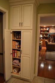 captivating white wooden kitchen pantry cabis with double door oak