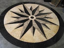brown hardwood floor with granite medallion that seems so