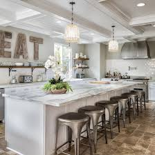 kitchen features a long island with white and gray marble