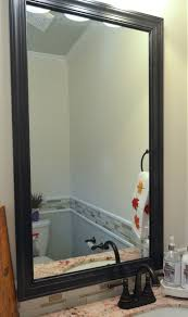 how to frame a mirror the builder u0027s installed a mom u0027s take