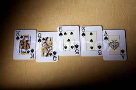 cards on the table a royal straight flush playing cards poker hand in spades cards for