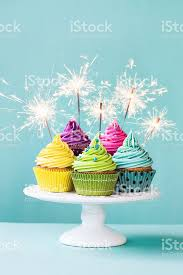 birthday sparklers cupcakes with sparklers stock photo more pictures of 2015 istock