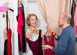 elderly woman clothes elderly smiling woman dressing in changeroom of clothing store