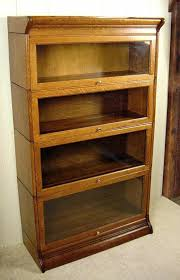horizontal bookcase with frosted glass doors and three drawers as
