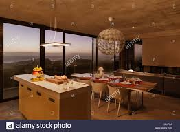 Breakfast Bar And Dining Table In Modern Kitchen Overlooking Ocean - Breakfast table in kitchen
