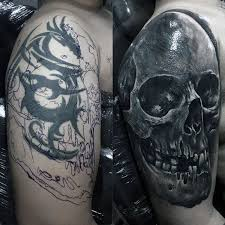 tribal to skull before and after mens arm cover up tattoos