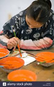 china xi u0027an female chinese artist painting ceramics with bright