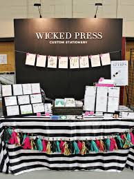 black display table cloth diy craft fair booth featuring risers made out of black foam core a
