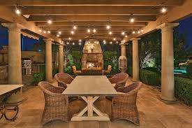 outdoor string lights comfortable wicker chairs and wooden table using sweet