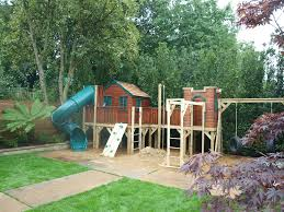 treehouse on a platform with activities and spiral slide