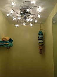 Bathroom Overhead Lighting by How To Use Lighting Mirrors Vanities And Color In A Condo Bath