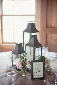 for sweetheart table a cluster of several small lanterns lm