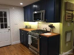blue kitchen cabinets with wood countertops blue hue painted cabinets cabinets