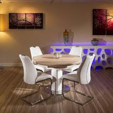 Round Dining Table Extends To Oval Round Oval Extending Dining Table Cau Oak Round To Oval Extending