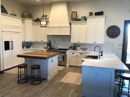 how to decorate space above kitchen cabinets tips for decorating the space above your kitchen cabinets