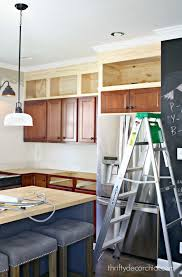thrifty decor chick beadboard backsplash cozy kitchens building cabinets up to the ceiling building cabinets thrifty