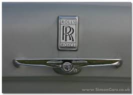 roll royce rills rolls royce badge meaning calinflector