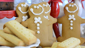 festive christmas food with gingerbread men fruit cake and
