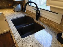 best kitchen sinks and faucets black granite composite sink with kohler rubbed bronze faucet