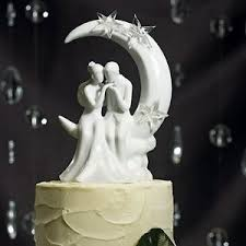 moon cake topper written in the groom sitting on moon wedding cake