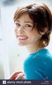 short brunette hairstyles front and back semi profile of female short brunette hair wearing blue v neck top