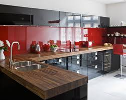 red kitchen accents light fixtures and built in refrigerator