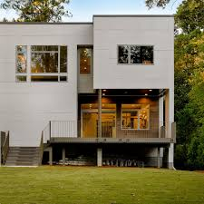 dark wood siding exterior modern with landscape faux stone fire