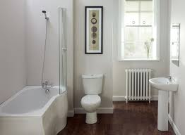 bathroom white daltile wall with black and white clawfoot tub