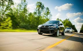 green bmw x5 2012 bmw x5 m vs jeep grand cherokee srt8 mercedes benz ml63 amg