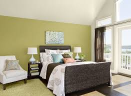 interesting bedroom design with dark wicker headboard and yellow
