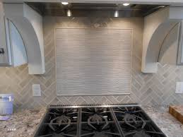 herringbone kitchen backsplash herringbone tile with accent feature over stove backsplash