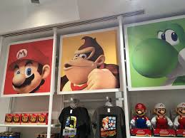 geddy visits the nintendo world store in new york city this store is home to a downright absurd amount of clothing as one might expect i won t even step foot in the door unless i m will to part with at least