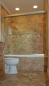 beige bathroom tiles wall design idea feat glass shower enclosure