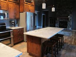 kitchen rustic alder cabinets snowflake granite my lake home