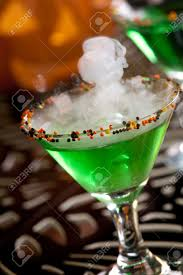 closeup of witch blood martini vodka gin vermouth and liquor