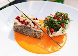 haute cuisine seabass haute cuisine dish with herbs stock photo serreitor
